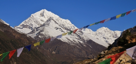 Scene near Namche Bazaar, Nepal. Prayer flags and snow capped mountains. Stock Photo