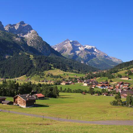 Village Gsteig bei Gstaad and high mountains.