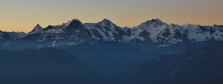 View from Mount niederhorn, Switzerland. Famous mountains Eiger, Monch and Jungfrau at sunrise. Stock Photo