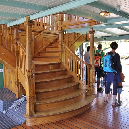 Timber staircase of the Blumlisalp paddle steamer. This nostalgic belle epoque steamboat was built in 1906 and is still in regular use on Lake Thun. Switzerland. Editorial