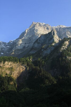 High mountain in Glarus Canton, Switzerland. Mount Glaernisch seen from Lake Kloental.