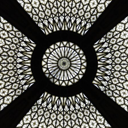 Mandala like glass ceiling of a post building in Barcelona.