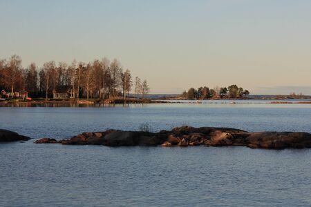 Rock formations and trees at the shore of Lake Vanern.