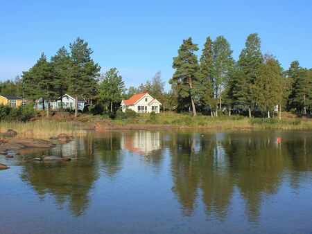 Trees and house at the shore of Lake Vanern.