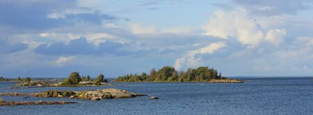 Rock formations and small islands near the shore of Lake Vanern, Sweden.