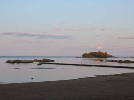 Rock formations and small island in Lake Vanern at sunset.$