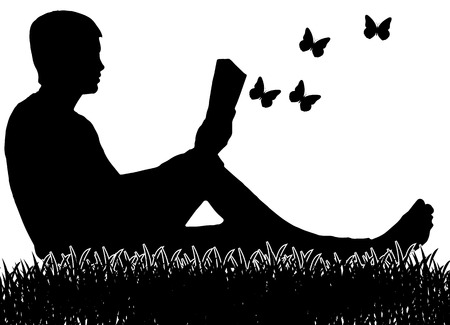 The man who is sitting on the grass and reading a book.