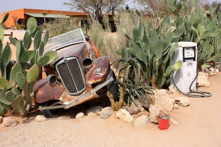 abandoned car: Solitaire, old car and gasoline station
