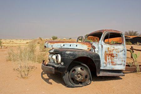 Old car in Namibian desert photo