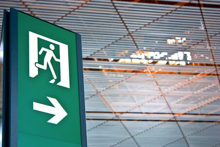 Sign of emergency exit in a Chinese airport, good for conceptual photo