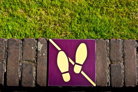 Sign: dont walk on the grass, useful for conceptual photo