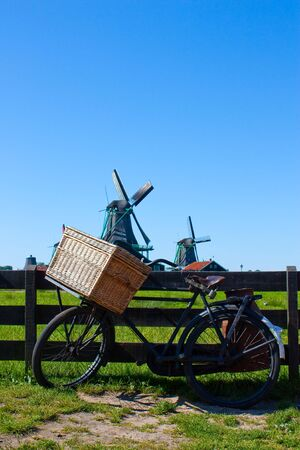 Clear and traditional landmark for Holland: bicycle and mills photo