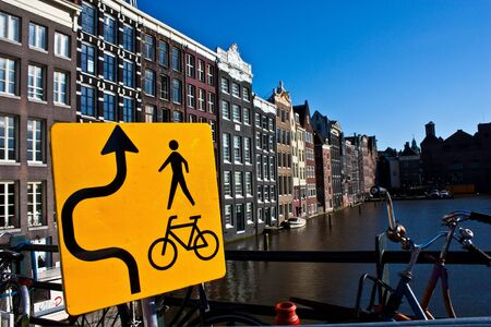 Amsterdam canal view with sign for bicycle, close to the center of the city photo