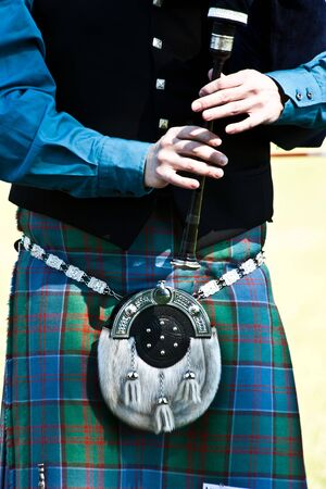 scot: Detail of a bagpipe exibition during Highland Games
