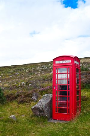 Traditional telephone box in Scotland, in the middle of nowhere photo