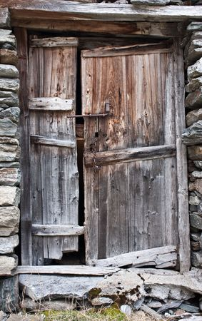 Old door made of wood, in Parco del Gran Paradiso, Italy photo