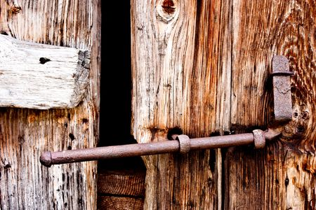 Detail of an old door made of wood, in Parco del Gran Paradiso, Italy photo