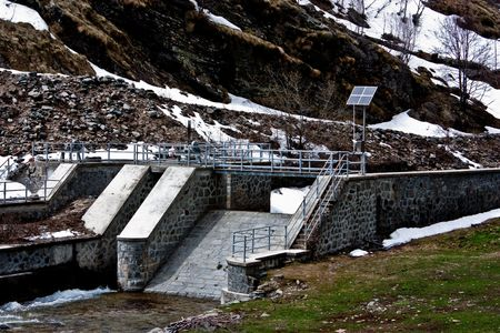 Dam with solar panel in Parco del Gran Paradiso, Italy photo