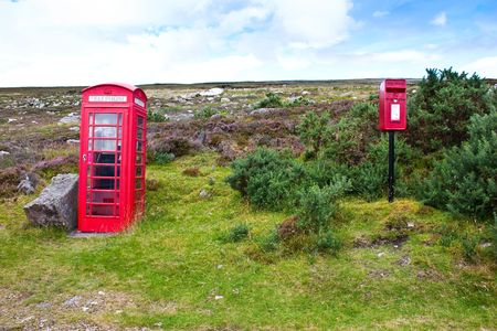 Traditional telephone and mail boxes in Scotland, in the middle of nowhere photo