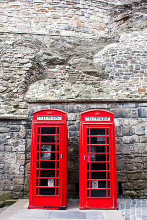 Traditional British landmark: two red telephone boxes in Edimburgh photo