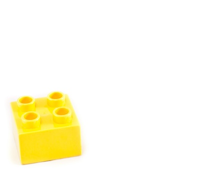 Plastic building blocks on white background. Bright colors. photo