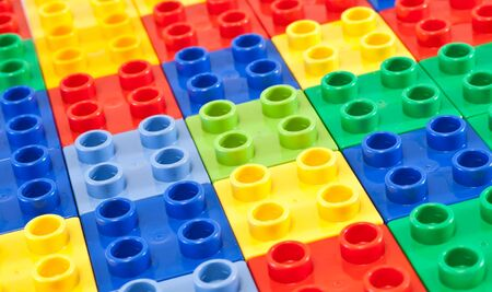 Background of plastic building blocks.  Bright colors. photo