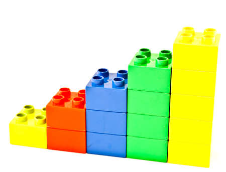 plastic bricks: Plastic building blocks on white background. Bright colors.