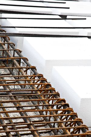 Technical detail of building operations: floor. Materials: polystyrene, steel bars, concrete photo