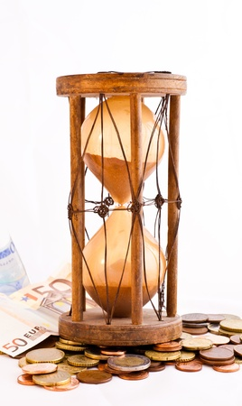 Old hourglass (made in India, XIX century) with euros Stock Photo