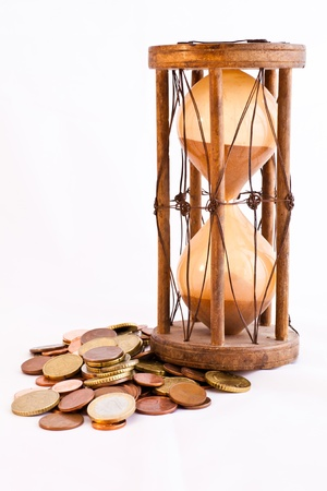 Old hourglass (made in India, XIX century) with euros photo