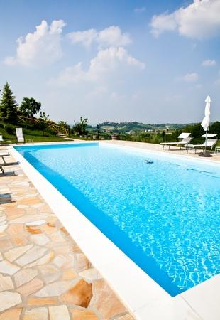 Swimming pool of an Italian beauty farm in the middle vineyards, Monferrato area, Piemonte region. Stock Photo - 9886673