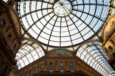 The Galleria Vittorio Emanuele II is a covered double arcade formed of two glass-vaulted arcades at right angles intersecting in an octagon, prominently sited on the northern side of the Piazza del Duomo in Milan. photo