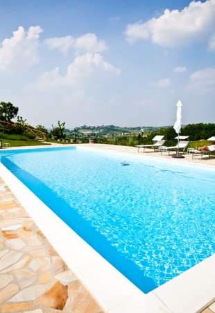 Swimming pool of an Italian beauty farm in the middle vineyards, Monferrato area, Piemonte region. photo