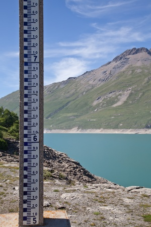depth measurement: Moncenisio dam, ItalyFrance border. Meter used to measure the level of water. Stock Photo