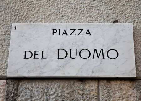 streetsign: Street sign of famous interesting point in Milan center - Italy Stock Photo