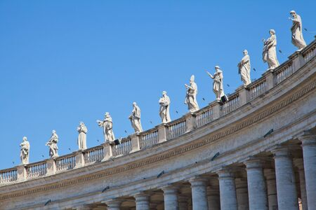 Statues in St. Peter Square (Rome, Italy) with blue sky background