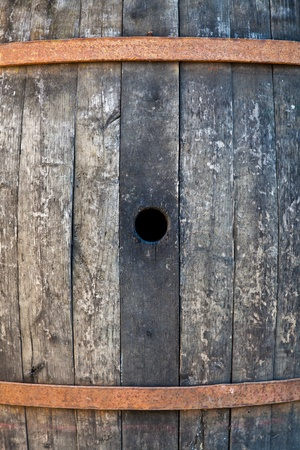 Old barrel made of wood used for Italian wine production photo