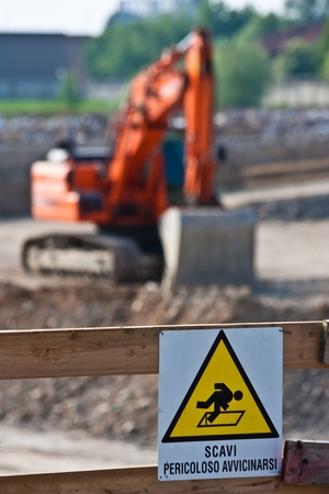 Sign of danger for work in progress (Italian) in a building site photo