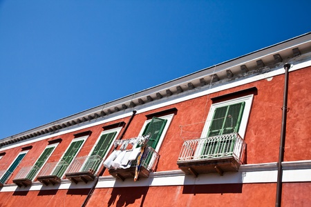 Detail of an ancient red house with a blue sky background in Procida Isle, Italy Stock Photo - 11112891