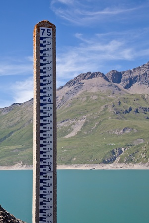 Moncenisio dam, ItalyFrance border. Meter used to measure the level of water. Stock Photo