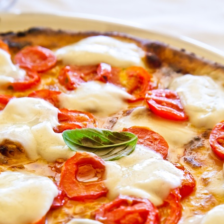 This is a true Italian Pizza. Traditional Pizza Margherita served in a Capris restaurant, Naples Gulf, Italy. Stock Photo