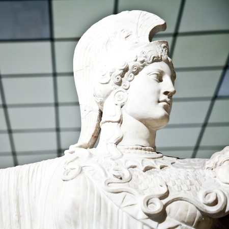 athena: In Greek mythology, Athena is the goddess of wisdom, courage, inspiration, strength, strategy, female arts, crafts, justice, and skill. Stock Photo