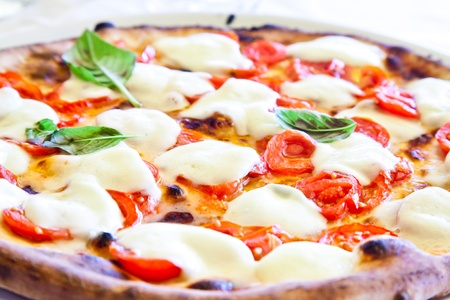 neapolitan: This is a true Italian Pizza. Traditional Pizza Margherita served in a Capris restaurant, Naples Gulf, Italy. Stock Photo