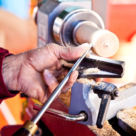 Old worker hands at lathe Stock Photo - 11902553