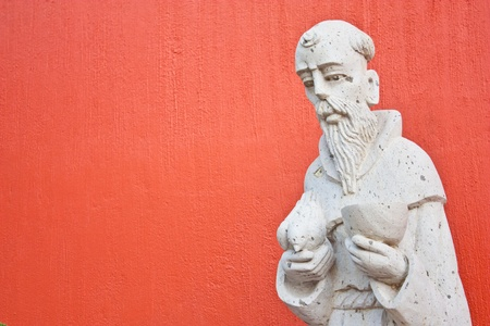 Saint Francis statue at the entrance of a Mexican church Stock Photo - 12580490