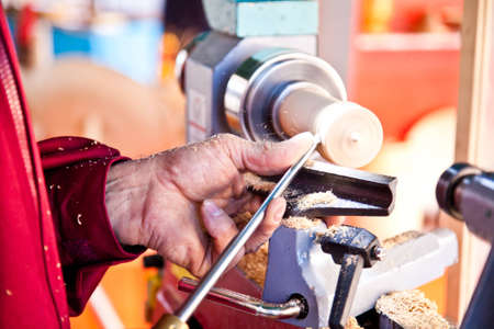 Old worker hands at lathe Stock Photo - 12590887
