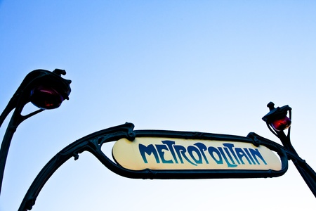 Traditional entrance sign of metro station in Paris. Clean sky in background, copy space