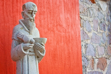 Saint Francis statue at the entrance of a Mexican church photo