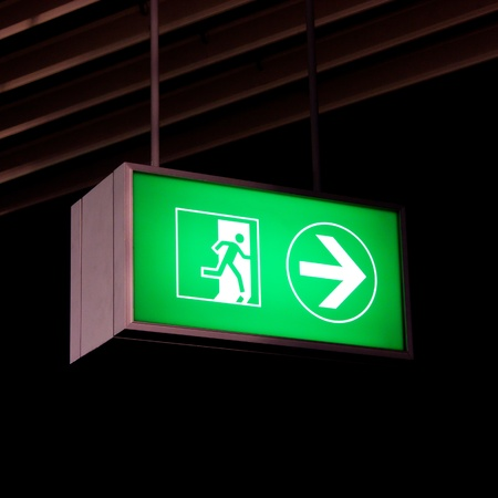 Emergency exit sign in modern offices inside an industrial plant photo