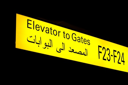 Gate sign in an international airport in Middle East with Arabic information